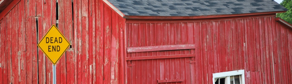 "Red barn with ""Dead End"" sign by Leslie Green"